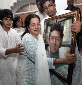 A prayer meet for late Bollywood music composer and singer Aadesh Shrivastava held at ISKCON temple in Juhu here on Tuesday. Aadesh Shrivastava,wife, son and family members jest before the prayer meet. Express photos By Dilip Kagda.08/09/05,Mumbai.