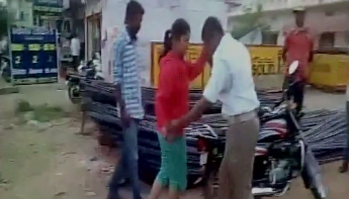 Girl Beating Traffic Police In Hyderabad